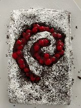 Chocolate zucchini cake, decorated with Debian swirl