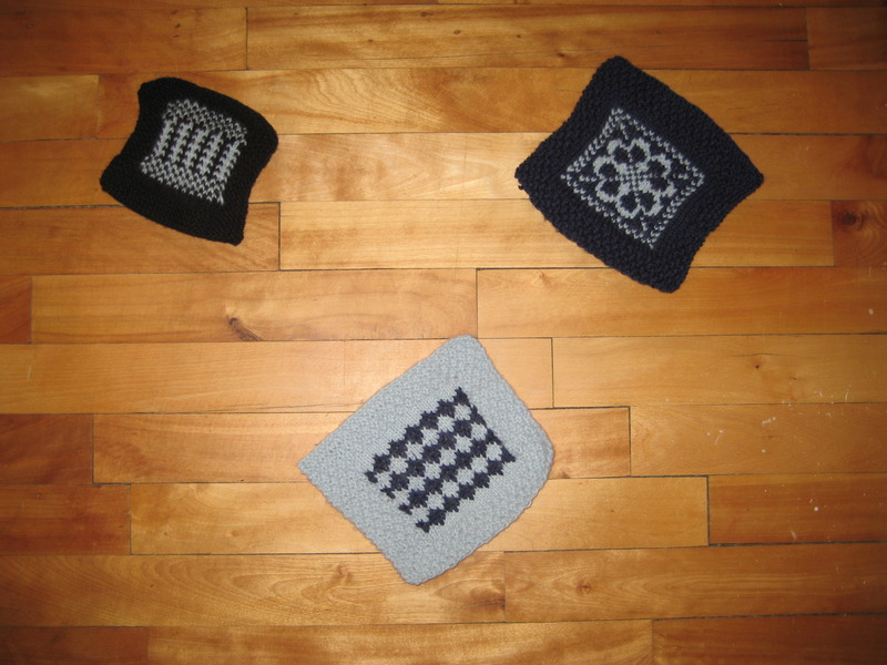 Picture of first attempts at 2-colour knitted squares - fronts