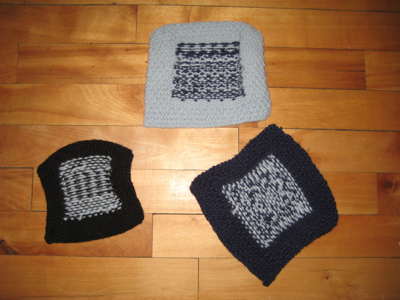 Picture of first attempts at 2-colour knitted squares - backs